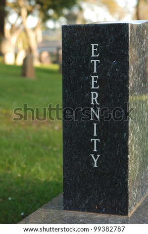 "Marbel gravestone with the word ""Eternity"" etched. - stock photo"