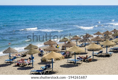 MARBELLA, ANDALUCIA/SPAIN - MAY 4 : View of the beach in Marbella Spain on May 4, 2014. Unidentified people - stock photo