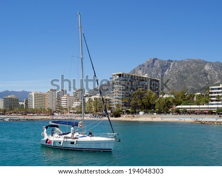 MARBELLA, ANDALUCIA/SPAIN - MAY 4 : Yacht sailing into the marina at Marbella Spain on May 4, 2014. Unidentified people. - stock photo