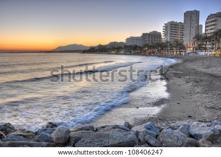 Marbella beach surprised at sunset. Marbella is one of the most important tourist cities of the Costa del Sol and throughout most of the year is an international tourist attraction. - stock photo