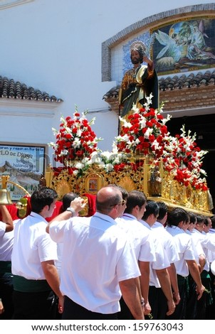 MARBELLA, SPAIN - JUNE 11, 2008 - Carrying the float (paso) into the church during the Romeria San Bernabe religious festival, Marbella, Spain, June 11, 2008 - stock photo