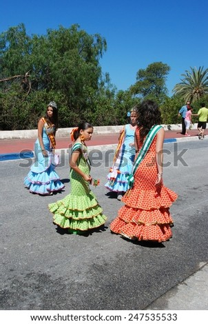 MARBELLA, SPAIN - JUNE 8, 2008 - Spanish Carnival Princesses walking along the street during the Romeria San Bernabe procession, Marbella, Costa del Sol, Andalusia, Spain, June 8, 2008. - stock photo