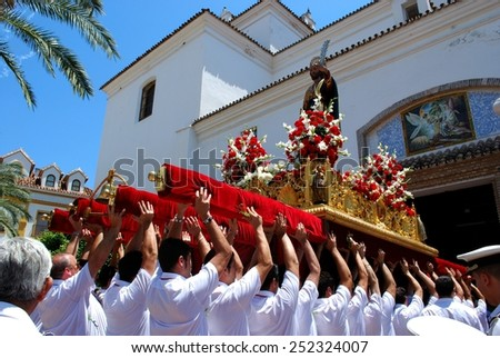 MARBELLA, SPAIN - JUNE 11, 2008 - Statue of Saint Bernard on the float being carried into the church at the Romeria San Bernabe, Marbella, Malaga Province, Andalusia, Spain, June 11, 2008. - stock photo