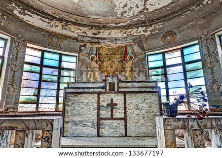 marble altar of an old abandoned catholic church - ancient italian catholic chapel with frescoes and wall glass - stock photo
