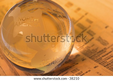 marble ball on the newspaper - stock photo