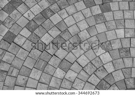 Marble Brick Sidewalk.  Walkway built of marble blocks and mortar in tones of silver, black, charcoal, and gray/grey, for use as background/message. - stock photo