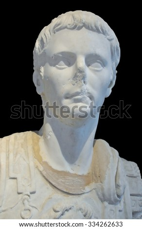 marble bust of a roman emperor isolated on gray background - stock photo