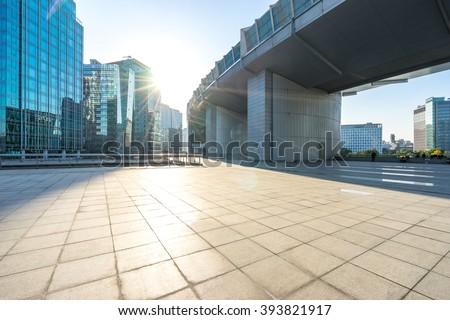 marble floor front of modern buildings in beijing - stock photo