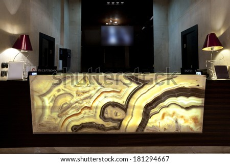 Marble reception desk in hotel - stock photo
