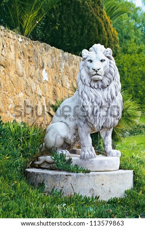 marble sculpture of a lion at the wall - stock photo