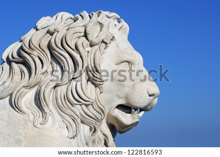 Marble sculpture of lion - stock photo