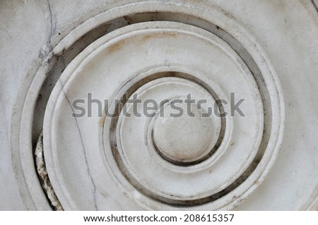 Marble spiral ancient greek ionic column detail. Abstract background. - stock photo