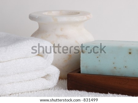 Marble Vase with soap and towels - stock photo