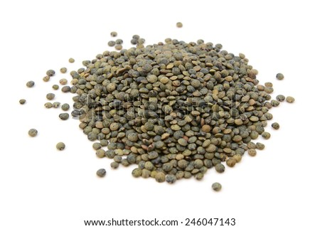 Marbled dark green lentils, isolated on a white background - stock photo