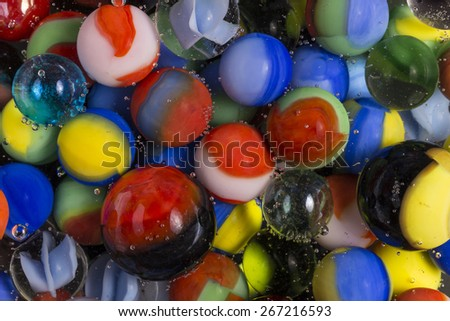 Marbles In Clear Soda - stock photo