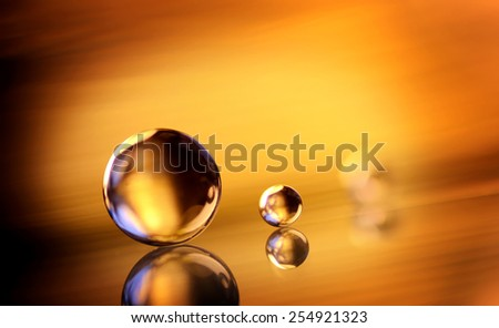 marbles on the golden background - stock photo