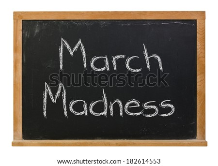 March madness written in white chalk on a black chalkboard isolated on white - stock photo