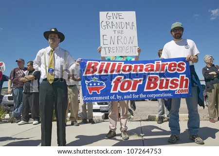 MARCH 2005 - Protestor in Tucson Arizona of President George W. Bush holding a sign proclaiming Billionaires for Bush - stock photo