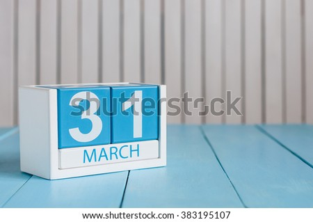 March 31st. Image of march 31 wooden color calendar on white background.  Spring day, empty space for text. World Backup Day and the month end - stock photo