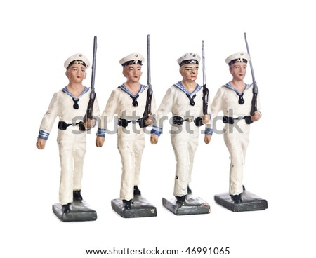 Marching Toy Soldiers isolated on white background - stock photo