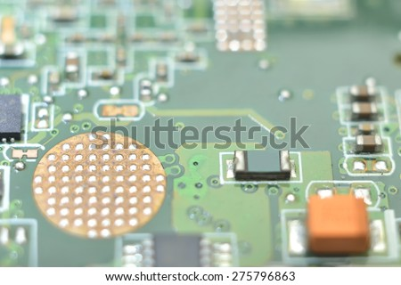marco microcontroller on system board background - stock photo