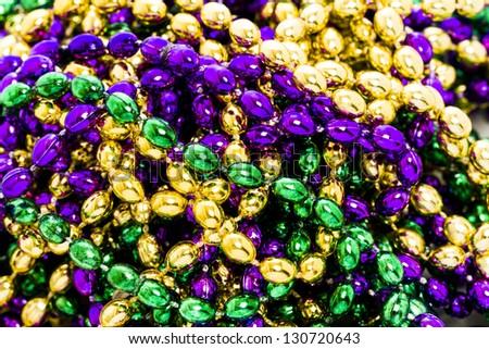 Mardi Gras beads on white backgound. - stock photo