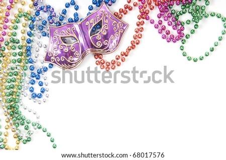 Mardi gras mask and beads - stock photo