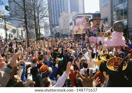 MARDI GRAS, NEW ORLEANS, LA - CIRCA 1990's: Crowd watching parade in New Orleans - stock photo