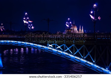 Margaret Bridge over Danube river and parliament Hungary  by night, Budapest, Hungary - stock photo