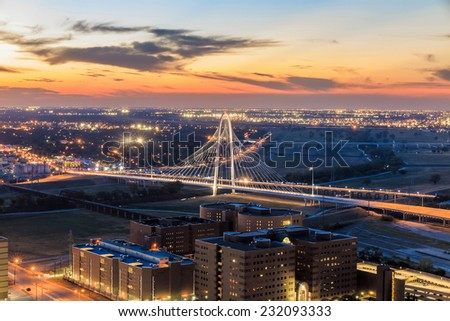 Margaret Hunt Hill bridge by night. Margaret Hunt Hill Bridge is a Santiago Calatrava-designed bridge built over the Trinity River. - stock photo