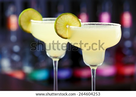 Margarita cocktail shot on a bar counter - stock photo