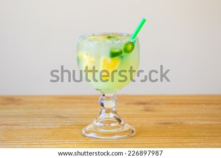 Margarita infused with jalapeno peppers at a restaurant bar. - stock photo