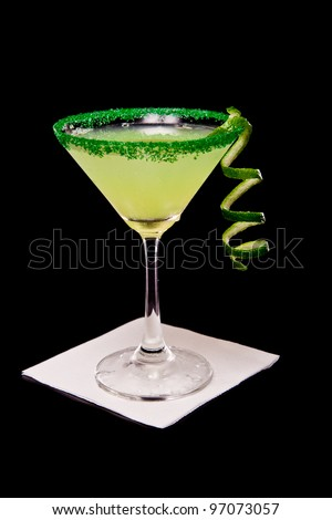 Margarita isolated on a black background garnished with a green sugar rim - stock photo