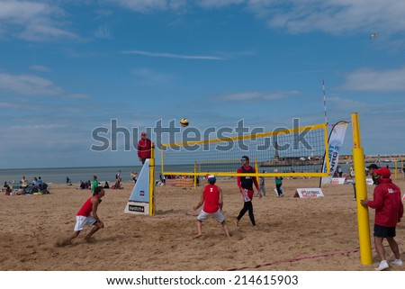 MARGATE,UK-AUGUST 16: Competitors practice on Margate Main Sands for the finals of Volley Ball England Beach Tour. August 16, 2014 in Margate, UK. - stock photo