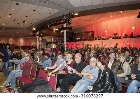 MARGATE, UK-SEPTEMBER 5: Members of the audience in the rally for Jeremy Corbyn's election to Labour party Leader, in Margate's Winter Garden. September 5, 2015, Margate, Kent UK. - stock photo