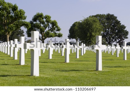 MARGRATEN - AUGUST 10: Crosses mark the graves of the more than 8000 soldiers whose remains have been buried at the American War Cemetery of Margraten in the Netherlands, on August 10, 2012. - stock photo