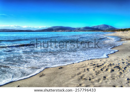 Maria Pia beach shoreline on a clear day. Processed for hdr tone mapping effect - stock photo