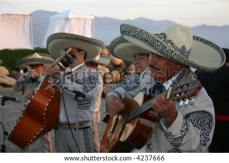 Mariachi Band Play Guitars in Mexico - stock photo