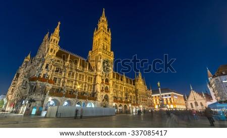 Marienplatz, Munich City, Germany. Beautiful Panorama scene view of Munchen night panoramic illuminated architecture under clear blue sky, New Town Hall and Frauenkirche at Night, Bavaria - stock photo