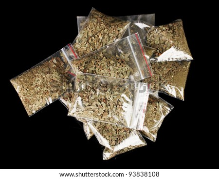 marihuana in packages on black background - stock photo