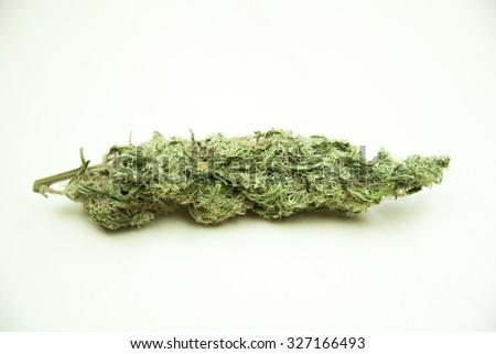 Marijuana buds. Therapeutic cannabis drug isolated on cleat background - stock photo