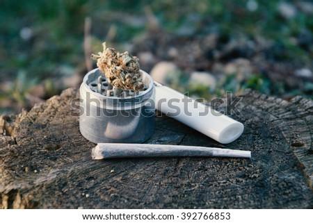 Marijuana Joint Grinder LighterStill Life - stock photo