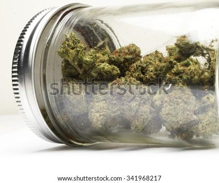 Marijuana Stash in a Glass Jar - stock photo