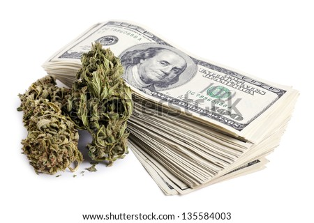 Marijuna buds and a large stack of 100 US dollar money notes isolated on white background. - stock photo