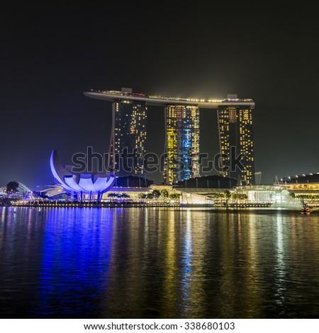 MARINA BAY SANDS, SINGAPORE NOVEMBER 05, 2015: Beautiful laser show at the Marina Bay waterfront, Singapore on November 05, 2015 - stock photo
