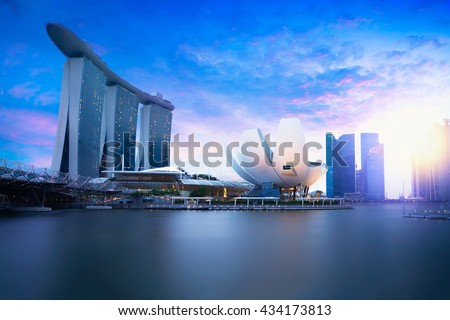 Marina bay Singapore at dusk, Singapore city skyline. Officially the Republic of Singapore - stock photo