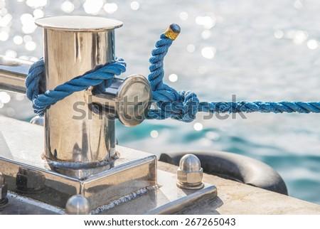 Marina bollard (bitt) at jetty for boats, ships and yachts mooring - stock photo