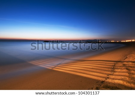 Marina di Massa, lights on the beach - stock photo