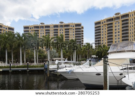 Marina resort in Cape Coral with luxury boats, palm alley, Florida - stock photo