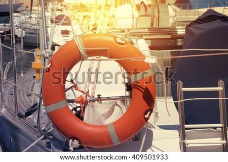 Marina with docked yachts - stock photo